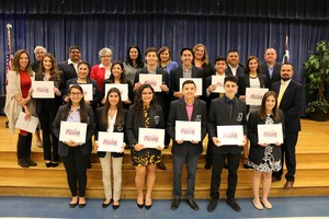 Picture of VMHS DECA students receiving certificates from the board of trustees for advancing to state competitions