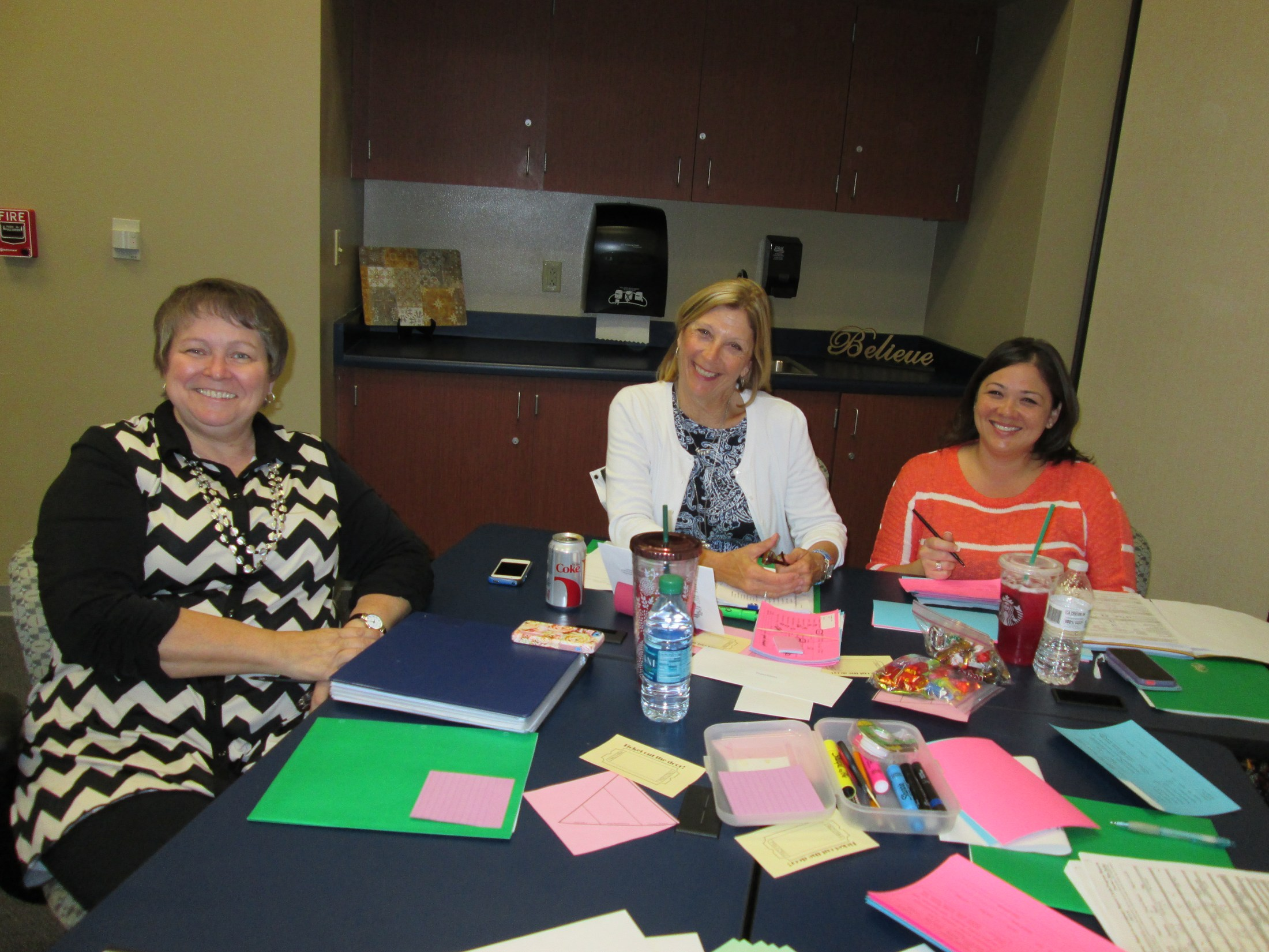 Teachers take a moment from training to smile for a photo.