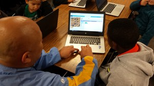 Teacher Gilbert Mendoza helps Vineland Elementary second-graders as they learn to code during the annual Hour of Code, an international effort to promote computer science education. Vineland students are engaging in the program throughout the week.