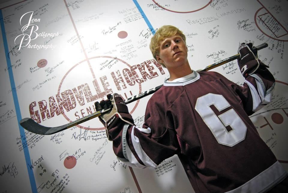 boy posing in hockey gear