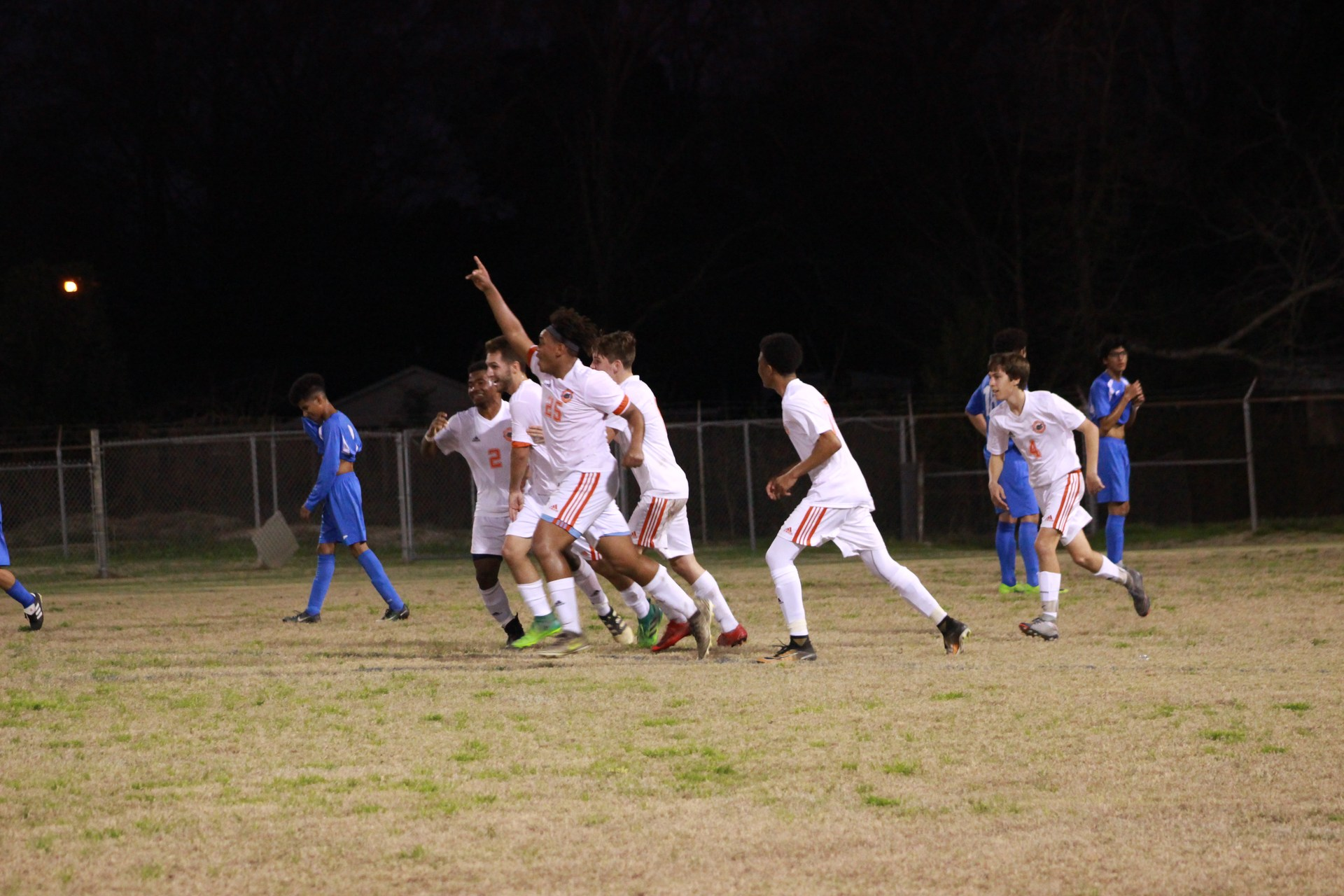 The soccer prepare for the next play.