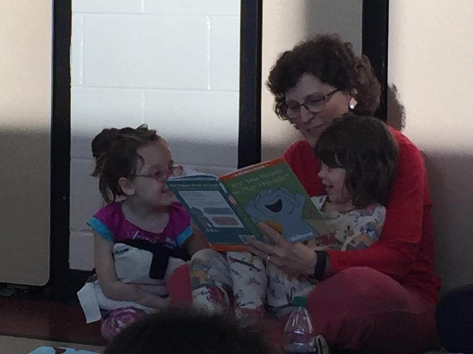 Mrs Gleason, kindergarten teacher with her students.