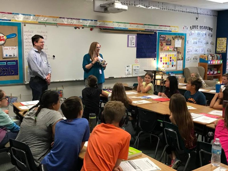 Rotary Member & Librarian present books