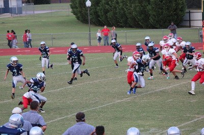 Varsity defense pursuing the ball carrier