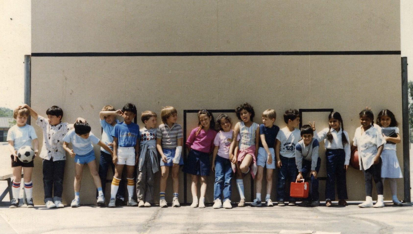 3rd graders at handball wall.