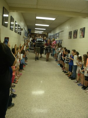 Graduates parade through the halls.