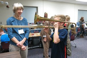 A student learns to play the trombone.