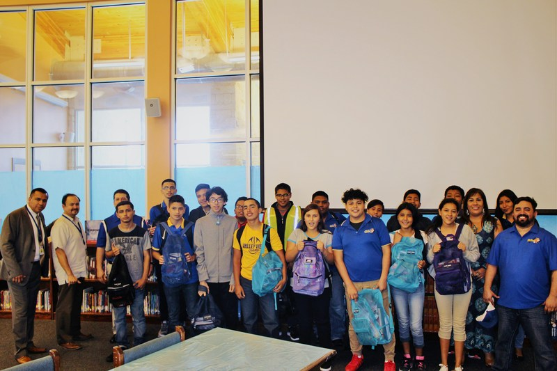 Our Board Members deliver backpacks and school supplies to our ECC Students. Thumbnail Image