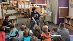 Mrs. Barb Davis reads a picture book to Mrs. Morrow's kindergarten class.