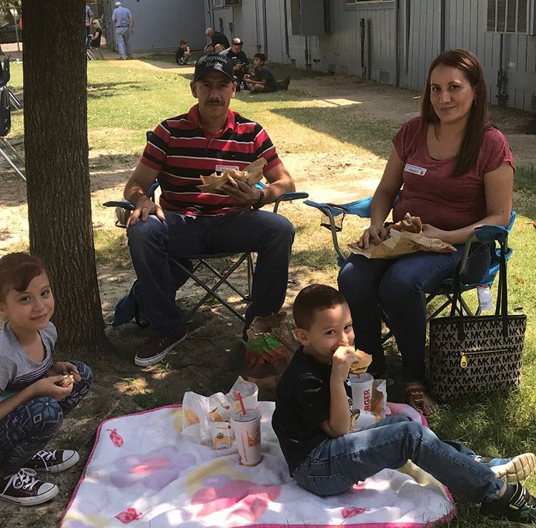 parents eating lunch with students on campus