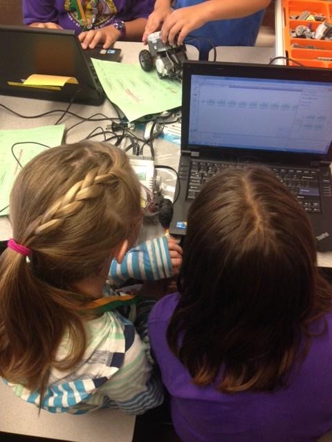 Students using robotics devices