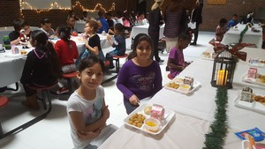Students sitting at table for manners monday