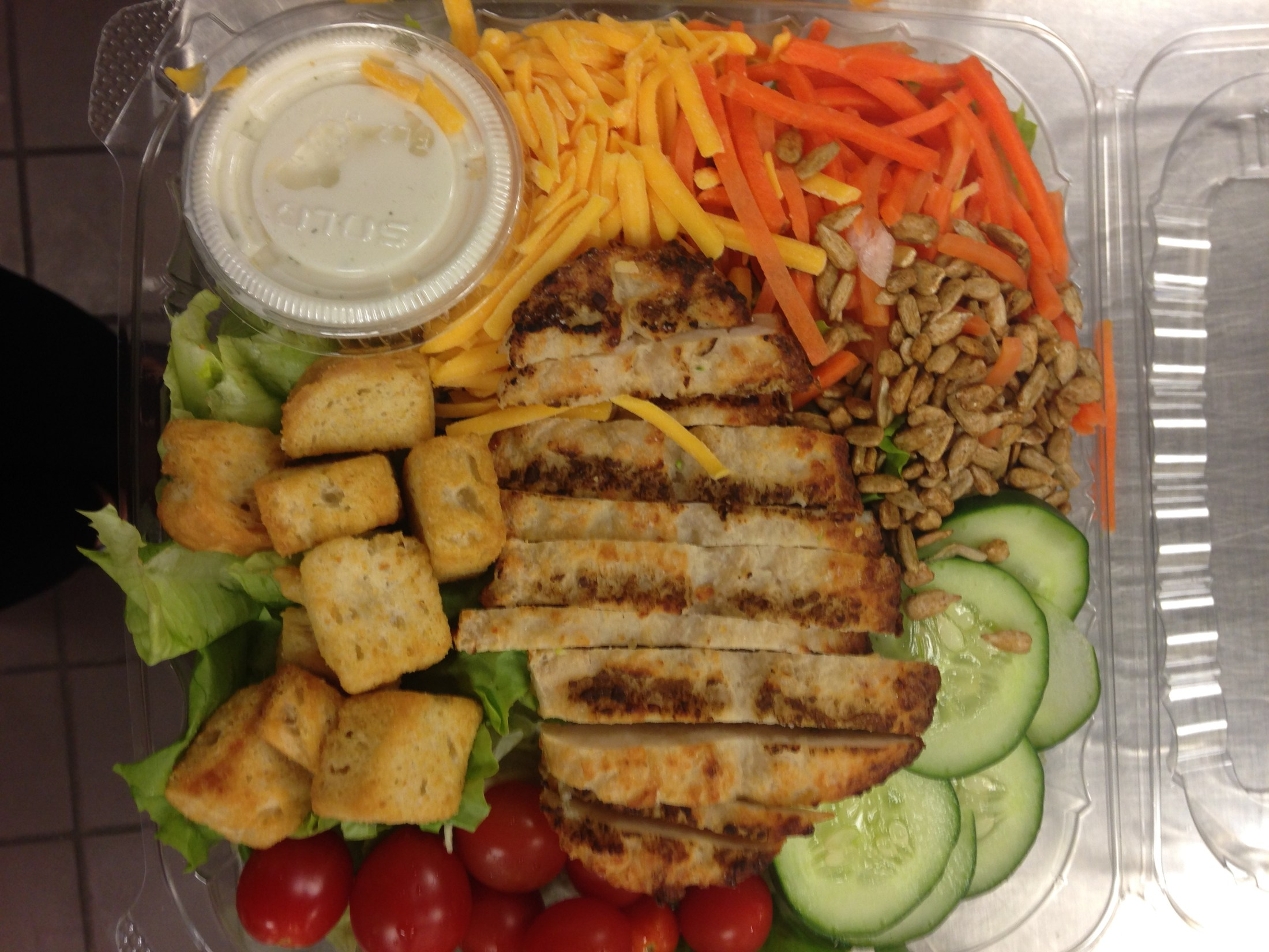 Signature salad tray with chicken.