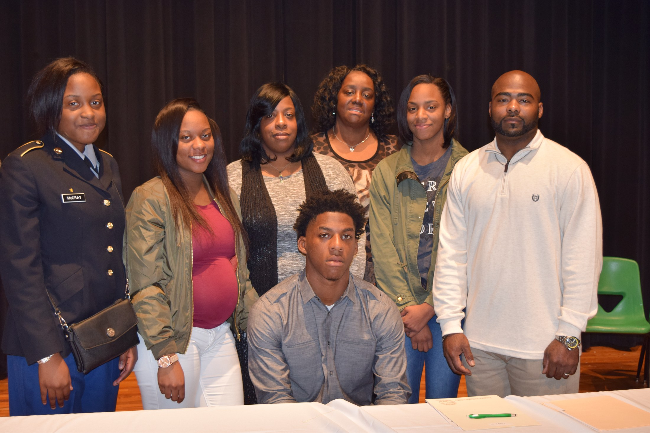 student with family on signing day