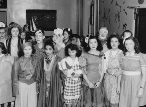 Group of students in costumes posing for the camera