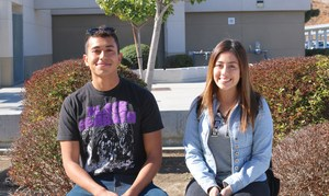 Adam Chacon and Samantha Gudiel Veliz sitting in front of Tahquitz High School