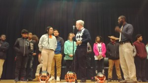 Board member Carr with spelling bee participants