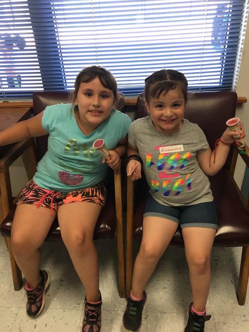 Girls sitting and enjoying frozen treats