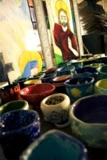 Colorful ceramic pots lined up after being fired in the kiln at OLSH