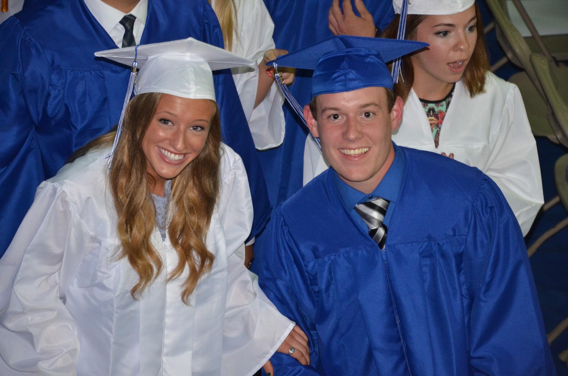 Two graduates smiling