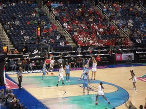 Basketball players during a game at the Greensboro Coliseum.