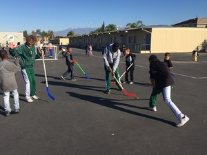 Tahquitz Cheerleaders playing hockey with Cawston students