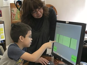 student playing braille game on screen