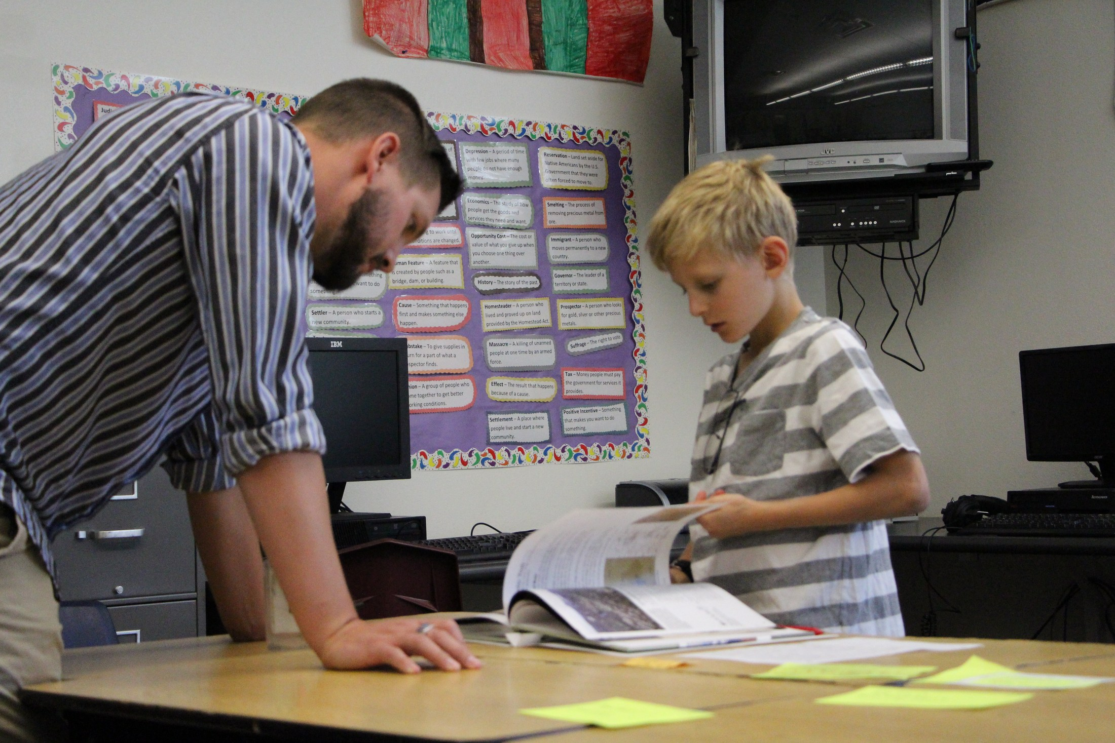 Teacher Riley Alderton works with one of his students.