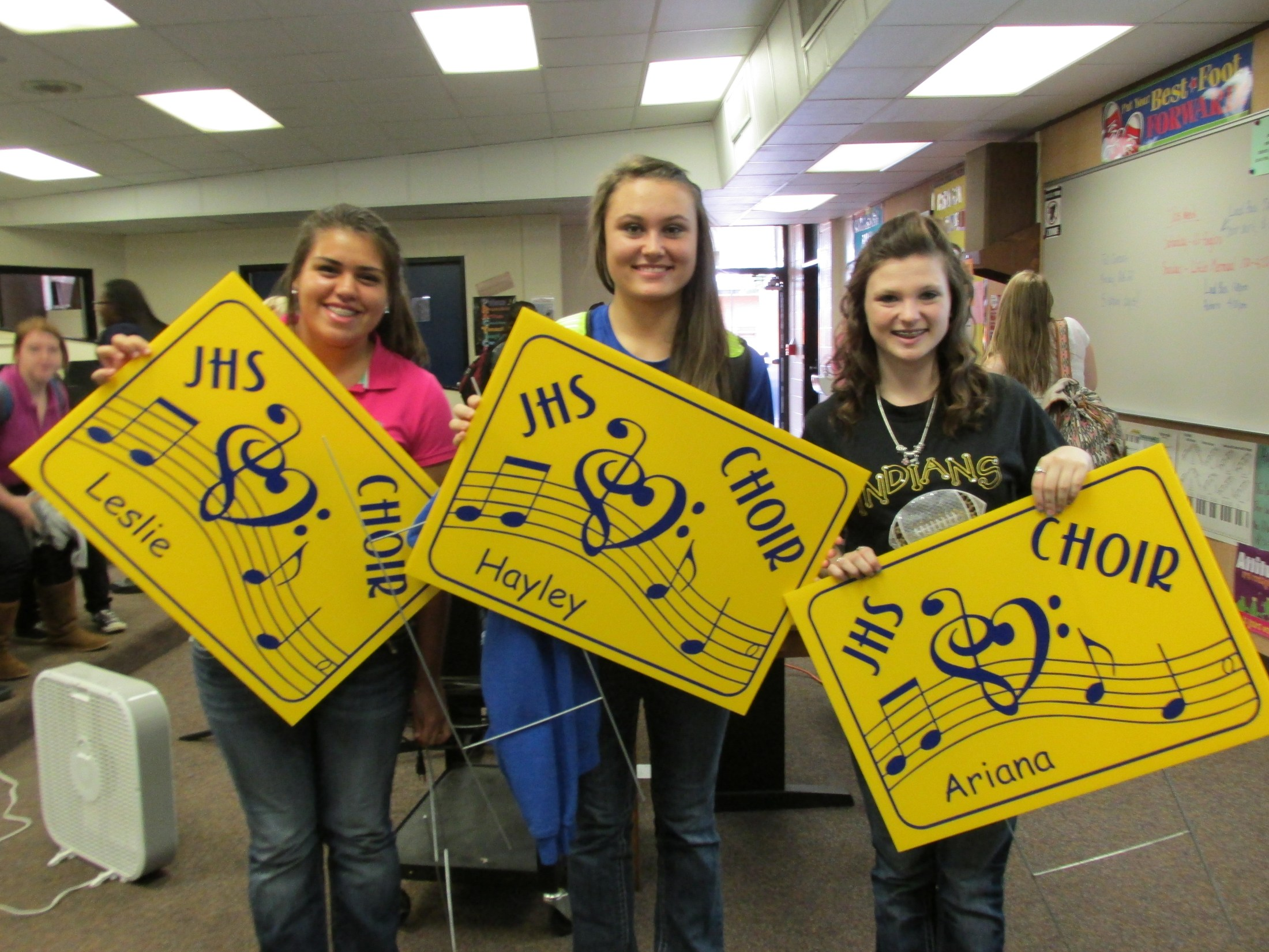 Students with new choir yardsigns