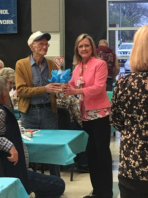Debra Crosby, Superintendent handing out a door prize.