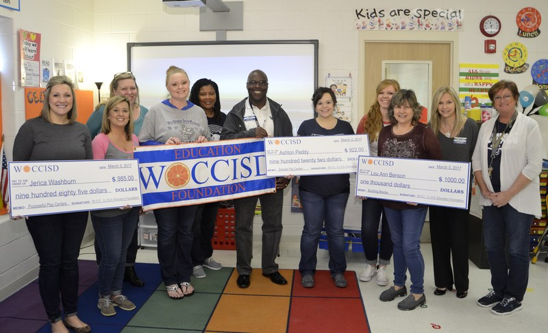 Teachers display grant checks!