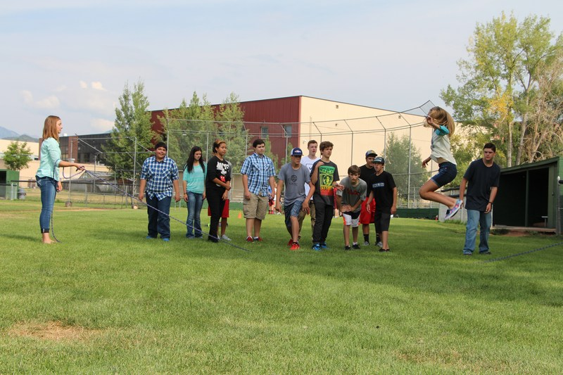 Students doing a team building exercise.