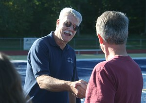 Frank Setlock shakes hand with former athlete.