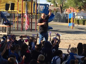 Asst. Principal Matt Norris leads Park Hill Elementary students in cheers for college