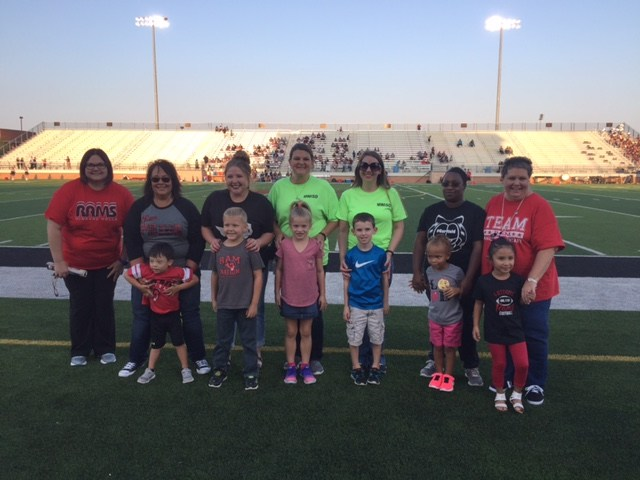 Lamar representatives at football game