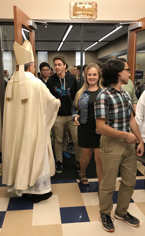 Auxillary Bishop Eusebio Elizondo greeting students after Mass