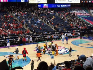 Mascots on the gym floor during a basketball game at the Greensboro Coliseum.