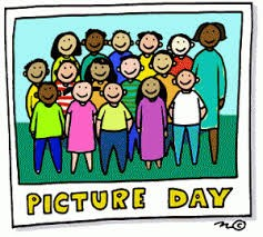 Picture of children and their teacher smiling and having their photo taken