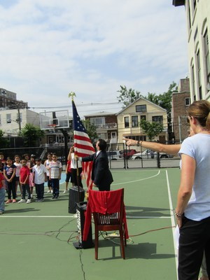 Mr. Celebrano straightening the American Flag