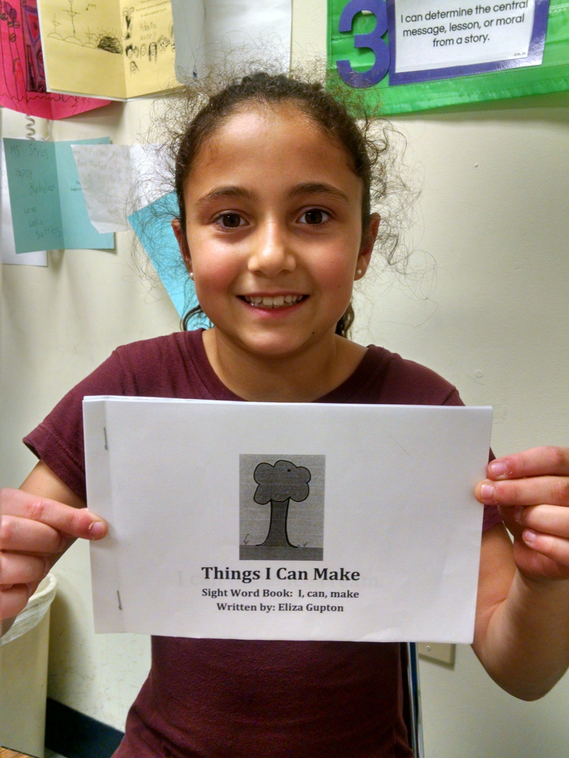 This is a picture of Eliza holding the book that she wrote. Her book is called, 'Things that I Can Make.'