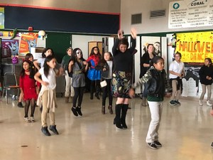 Principal Laxton showing off her dance moves at the 4th-5th Halloween Celebration.