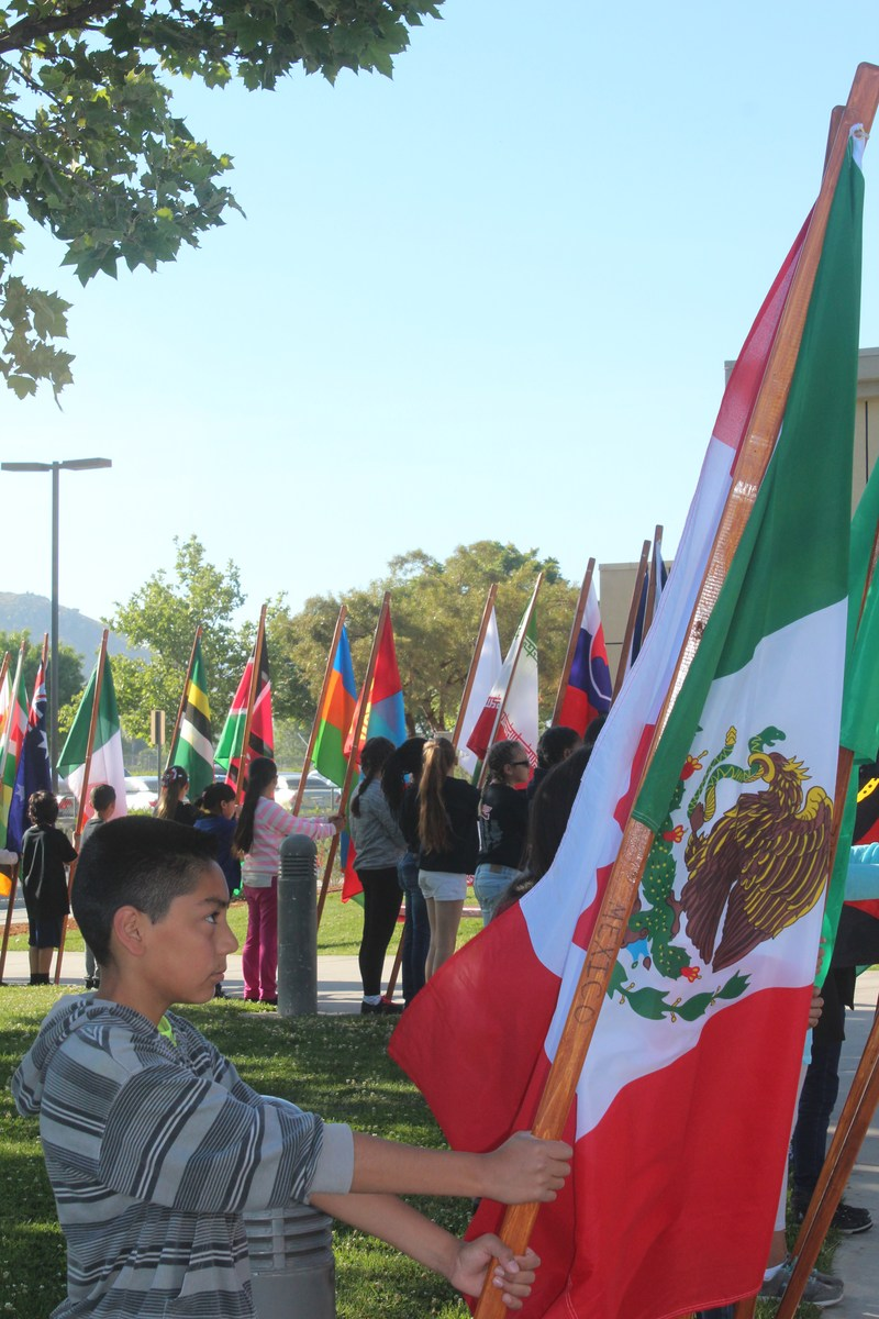 Students holding 32 different flags