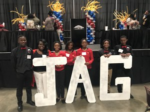 Photo of BMS JAG students behind JAG large letters at Lafayette Conference