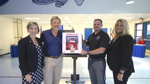 Superintendent Barrett, Robert Roy, Lyle Radford, and Lucy Dressel with an AED