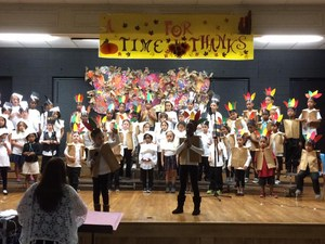 1st grade students singing at their Thanksgiving performance.