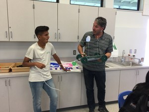BPUSD_Jones_STEM_2: Jones Junior High School eighth-grader Ivan Rosales discusses the design of his metal car with teacher Sergio F. Dallator during an Automation and Robotics class, held in the school's new STEM lab.