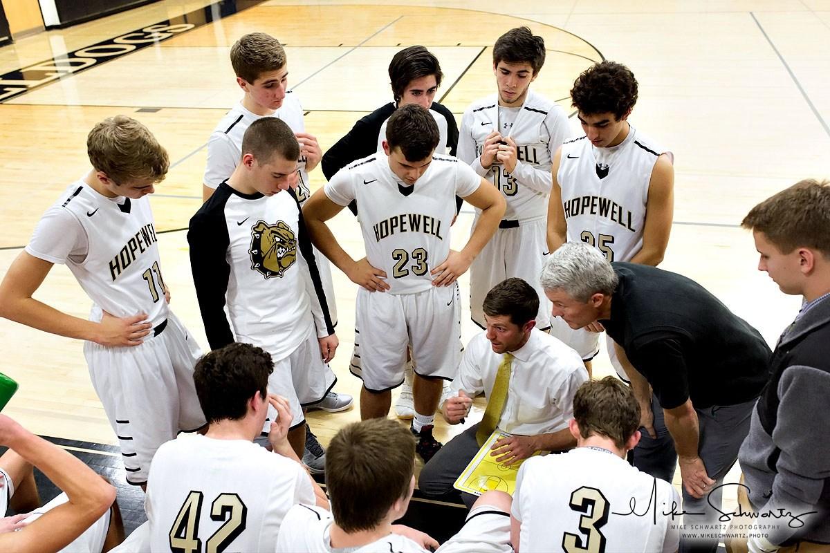 CHS boys basketball team huddles around coach