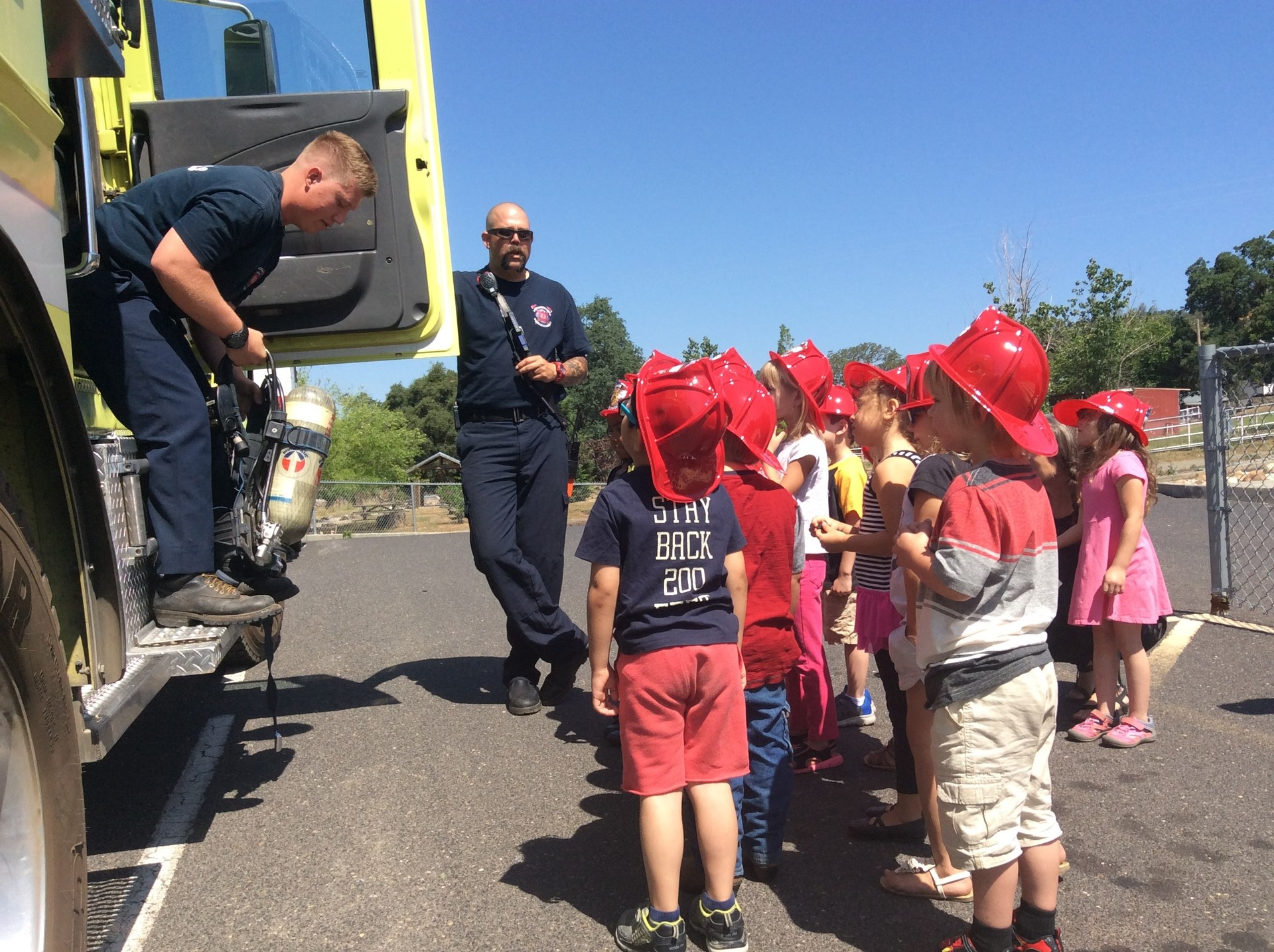 children and a firemen
