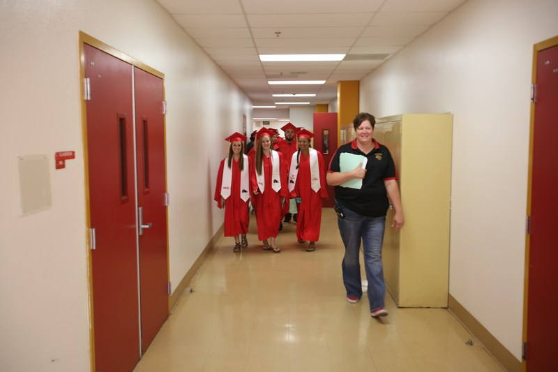 Dr. Shaw escorts seniors on last walk.