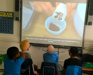 Students viewing a video on baking their sales items.